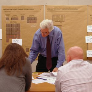 John Sawyer reviews documents with clients in the office