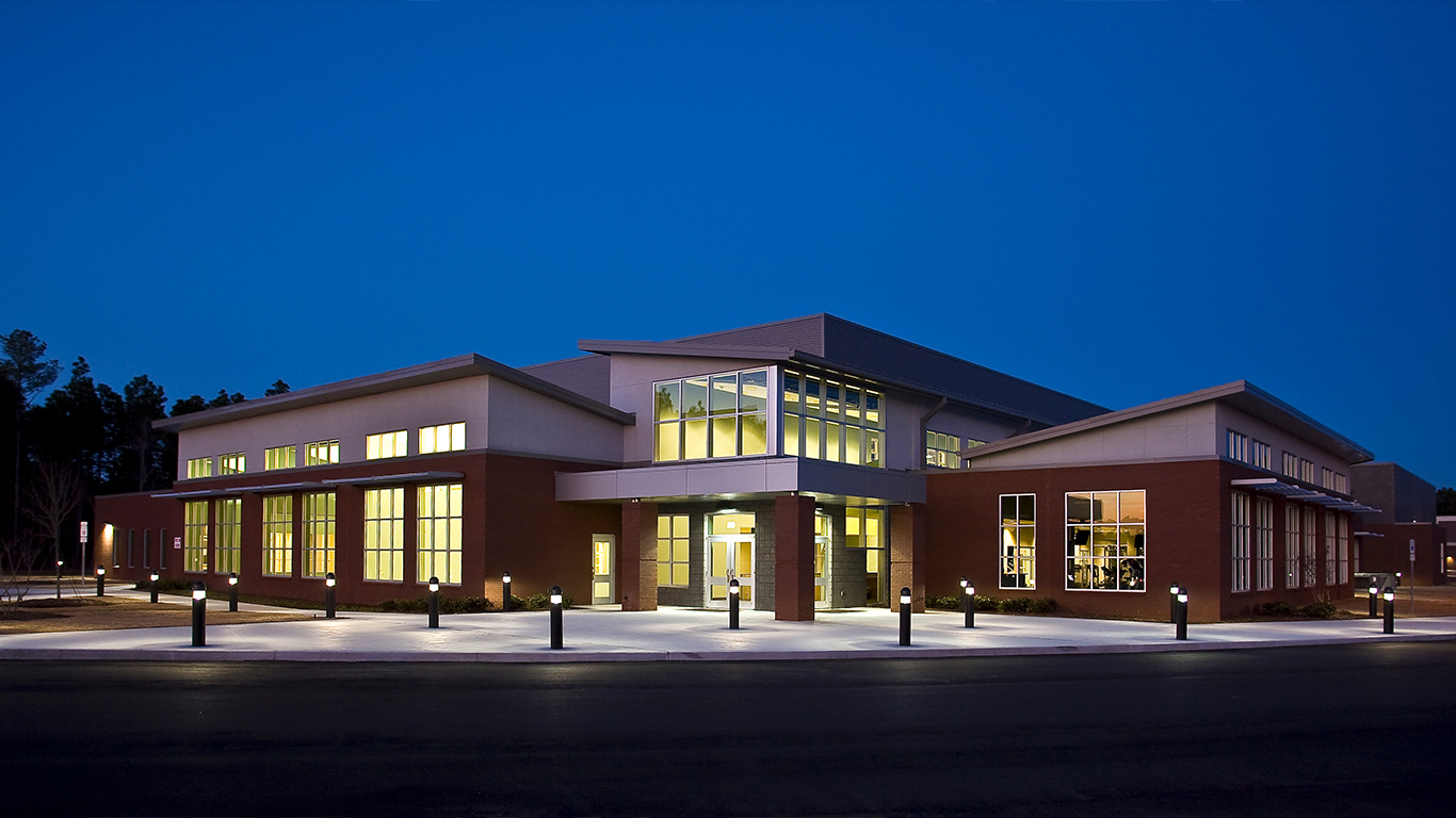 The exterior of the Dinah E. Gore Fitness & Aquatics Center after sunset