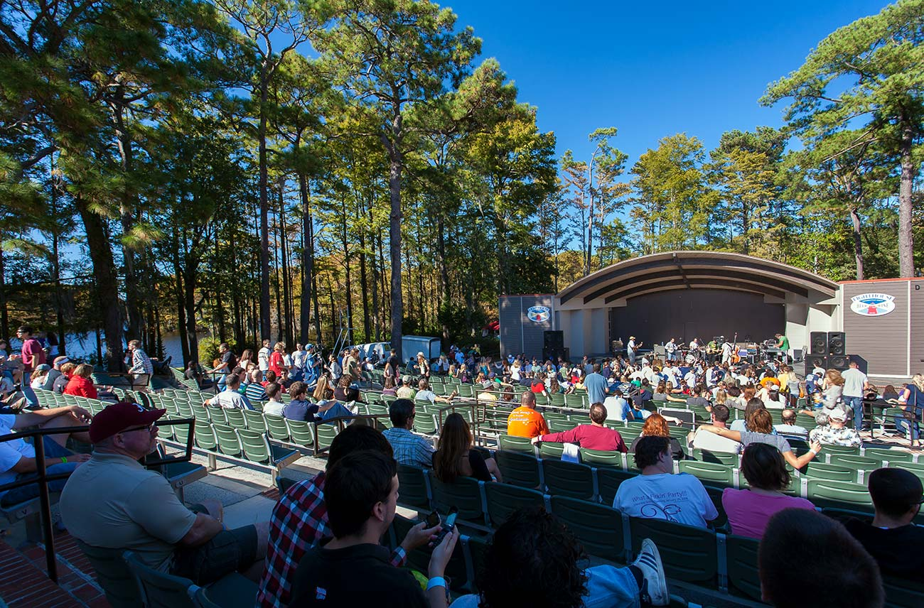 A crowd enjoys a concert in the open-air Greenfield Lake amphitheater