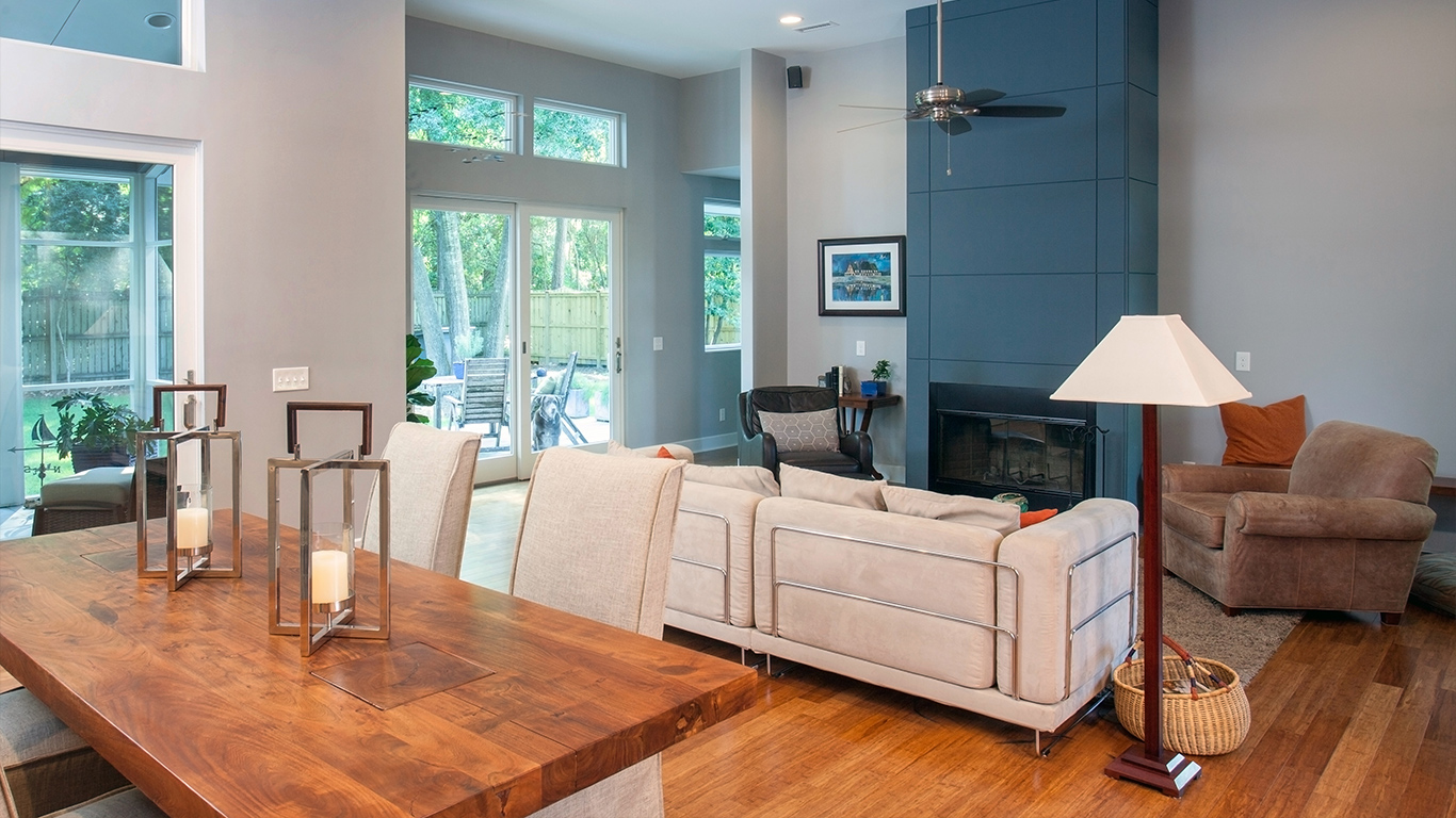 A comfortable living area includes a tall modern fireplace in the Faison Residence