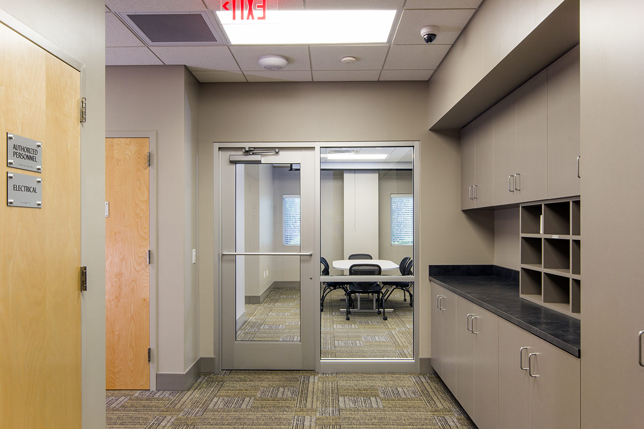 A view into a meeting room from a hallway in the Whiteville BEMC building