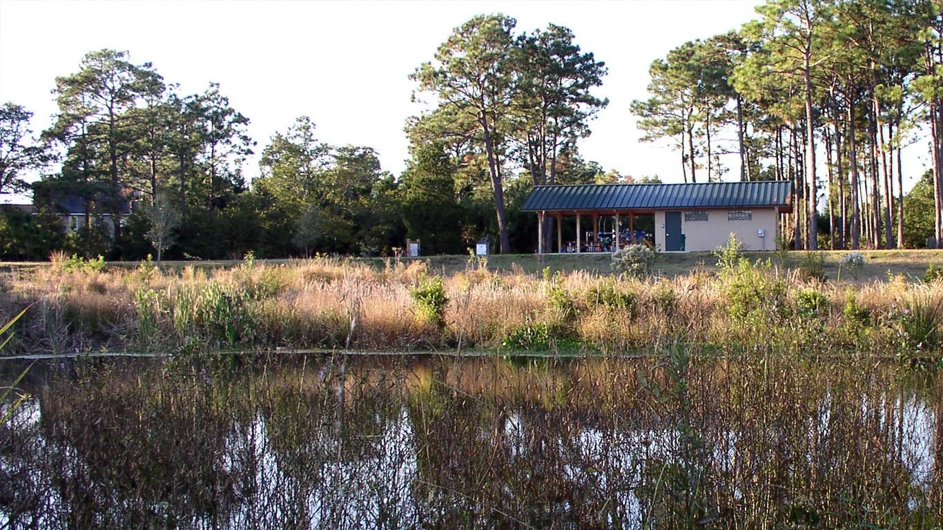 A picnic shelter near a pond at the James E.L. Wade park