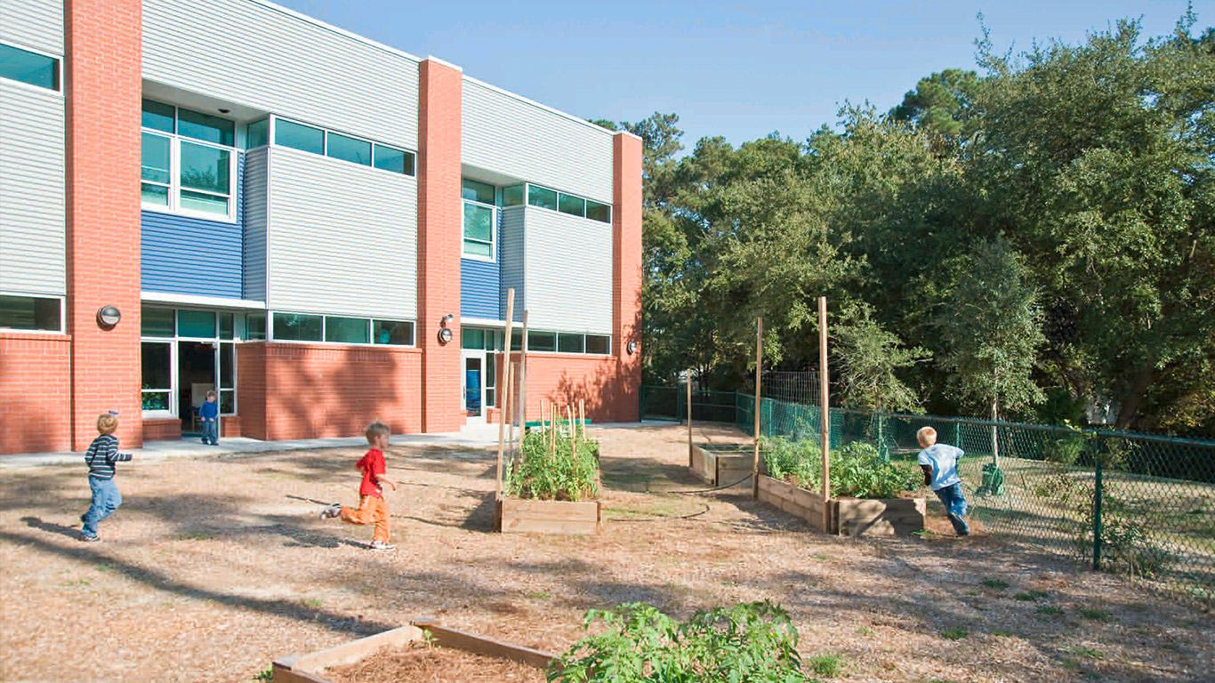 Children run in the outdoor playground of the Ogden Elementary school