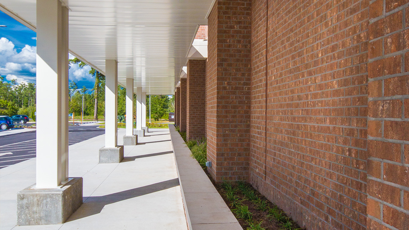 A covered walkway on the exterior of the Waccamaw School
