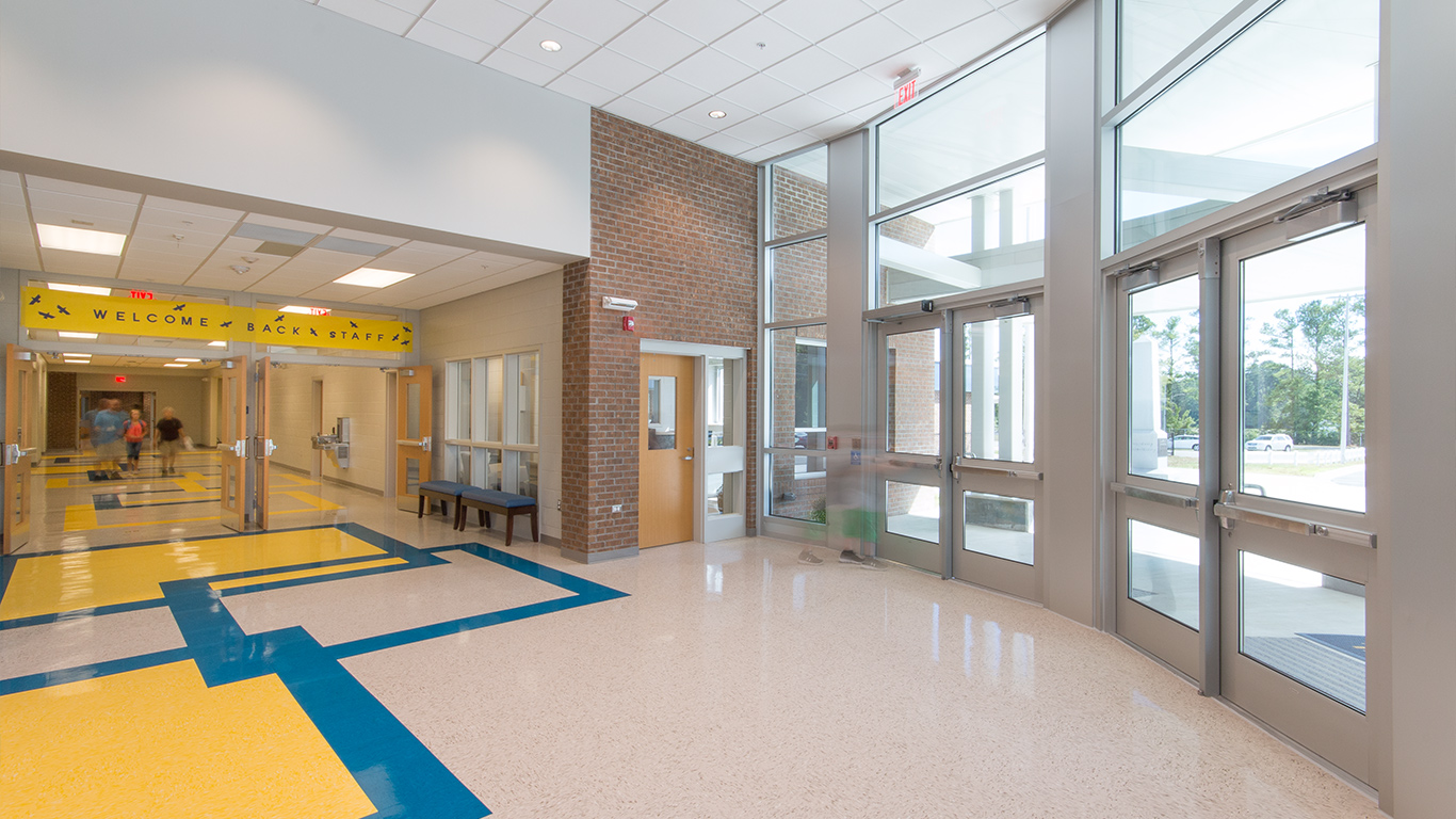 The glass double entrance doors to the Waccamaw School